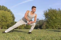 Full length of confident man exercising in park Stock Photo