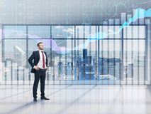 Full-length confident person in formal suit. A modern panoramic office with New York city view and forex chart. Stock Images