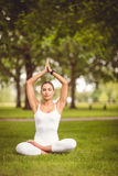Full length of confident woman sitting in lotus pose Royalty Free Stock Photo