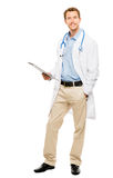 Full length of confident young doctor holding clipboard on white Stock Image