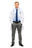 Full length of confident young doctor on white background. Full length of confident young doctor smiling stock photo