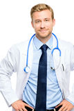 Full length of confident young doctor on white background Royalty Free Stock Image
