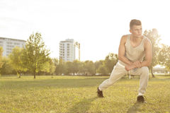 Full length of confident young man exercising in park Royalty Free Stock Image