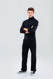 Full length of confident young man standing with arms crossed Stock Photography