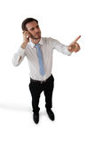Full length of confused businessman touching invisible interface. Against white background Stock Photo