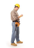 Full length construction worker. Contractor or architect builder standing full length while writing royalty free stock photography