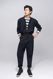Full length of cool fashion male model. Handsome asian man. Royalty Free Stock Photography