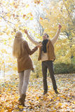 Full length of couple enjoying in autumn Royalty Free Stock Images