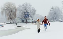 Full Length Couple Happy Smiling Laughing Holding Hands Walking Winter Snow Portrait Meadow Landscape Christmas New Year. Holidays Stock Images