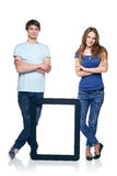 Full length couple with tablet frame Stock Images