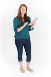 Full Length Cut Out Of Teenage Girl Using Digital Tablet royalty free stock photography