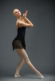 Full length of dancing athlete Stock Images