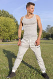 Full length of determined jogger standing in park Royalty Free Stock Photography