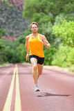Full Length Of Determined Man Running On Road Stock Image