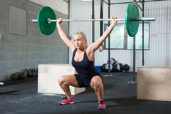 Determined Woman Lifting Weights In Health Club Royalty Free Stock Photo