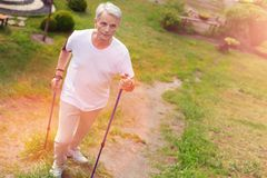 Full length of elderly man with crutches royalty free stock images