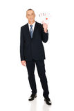 Full length elegant business man with four aces Royalty Free Stock Photo