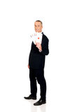 Full length elegant business man with four aces Royalty Free Stock Photos