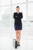 Full length of an elegant businesswoman in suit with briefcase in office Royalty Free Stock Photo