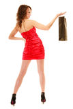 Full length of elegant girl in red dress with black shopping bag Royalty Free Stock Photography
