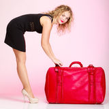 Full length elegant lady in voyage, traveler woman with old red bag Stock Photos