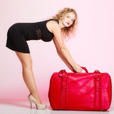 Full length elegant lady in voyage, traveler woman with old red bag Royalty Free Stock Images