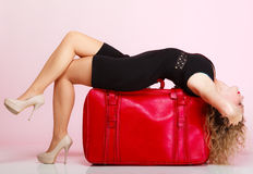 Full length elegant lady in voyage, traveler woman with old red bag Royalty Free Stock Photography