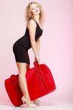Full length elegant lady in voyage, traveler woman with old red bag Stock Image