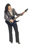 Full length of executive woman with guitar Royalty Free Stock Photography