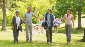 Full length of an extended family in park Royalty Free Stock Photo