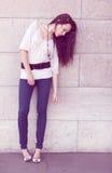 Full length fashion girl posing on street Stock Photos