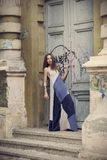 Full length fashion portrait modern woman standing near old door Royalty Free Stock Images