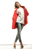 Full length fashion woman in red coat. Royalty Free Stock Image