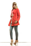 Full length fashion woman in red coat. Royalty Free Stock Images