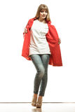 Full length fashion woman in red coat. Royalty Free Stock Photo