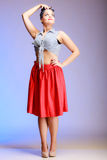 Full length fashionable pin-up girl sexy woman with bun on violet Stock Photo