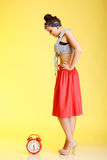 Full length fashionable pin-up girl woman with red clock Royalty Free Stock Photos