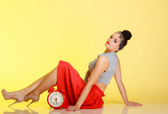 Full length fashionable pin-up girl sexy woman with red clock Stock Photos