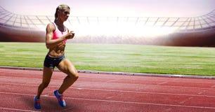Full length of female athlete running on racing track. Digital composite of Full length of female athlete running on racing track Royalty Free Stock Images