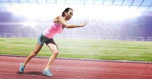 Full length of female athlete running on racing track. Digital composite of Full length of female athlete running on racing track Royalty Free Stock Photos