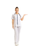 Full length female doctor presenting copyspace Stock Photo