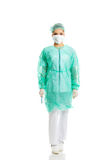 Full length female doctor with a scalpel Royalty Free Stock Photo