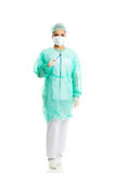 Full length female doctor with a scalpel Royalty Free Stock Image