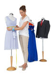 Full length of a female fashion designer and mannequin Royalty Free Stock Images