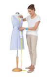 Full length of a female fashion designer and mannequin Stock Photo