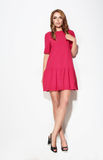 Full length of  female in pink dress. Royalty Free Stock Photography