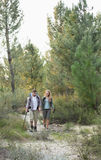Full length of a fit couple exploring the woods Stock Photo