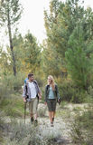 Full length of a fit couple exploring the woods Stock Photography