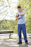 Full length of fit man checking time in park Stock Images