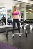 Full length of a fit woman in gym Stock Photography